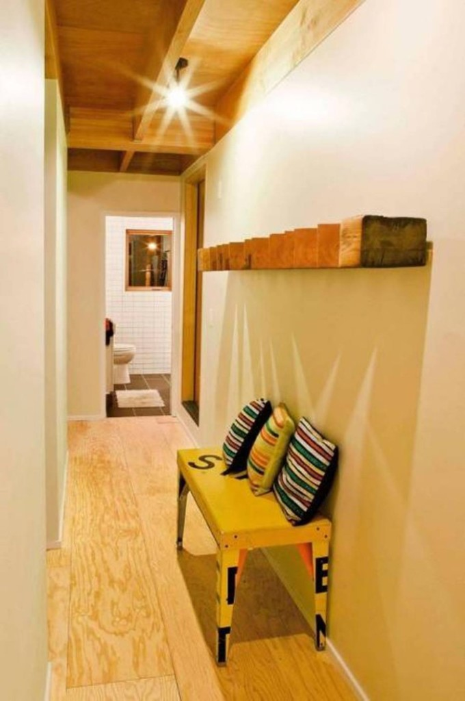 narrow-hallway-decorating-ideas-small-bench-and-cushions-700x1054