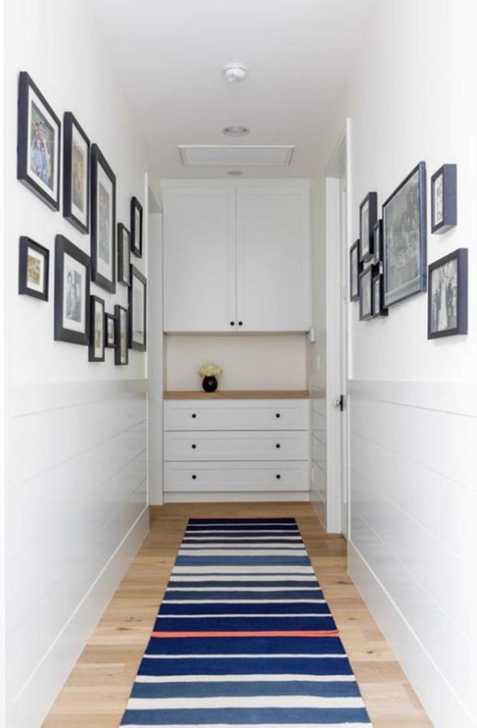 narrow-hallway-decorating-ideas-with-framed-wall-photos-and-striped-runner