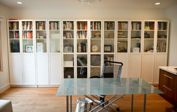 Simple-and-sleek-bookshelf-design-with-glass-doors-for-the-home-office